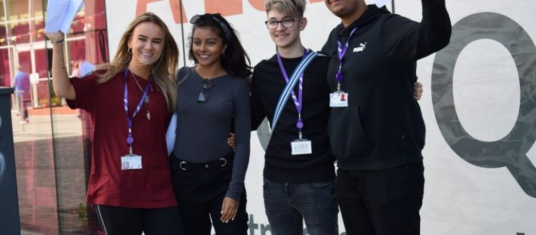 Small group of A-Level students with their exam results