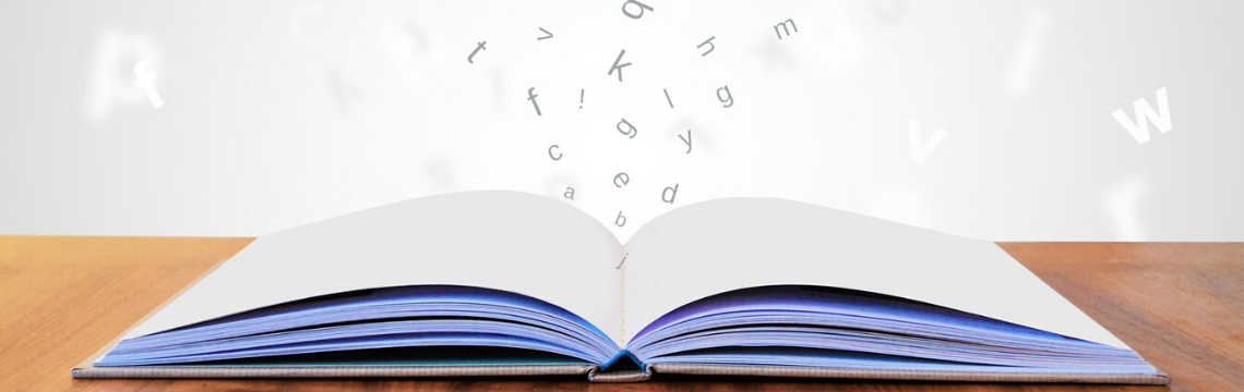 An open book with computerised letters emerging from it