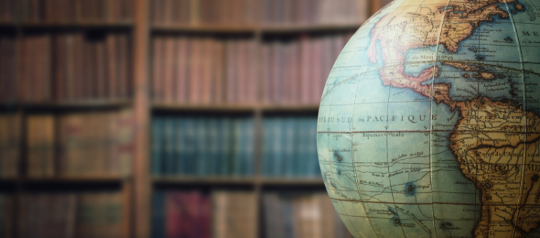 Historical globe placed inside a library