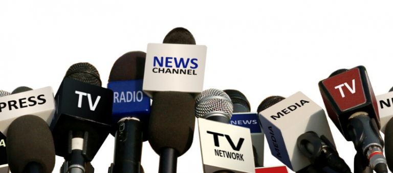 Microphones with press, TV, radio and news titled on the front