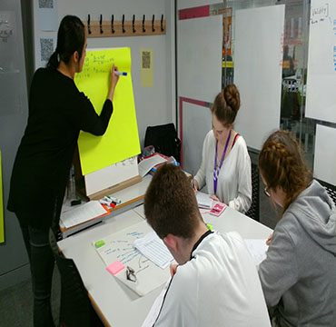 Teacher using whiteboard in revision session