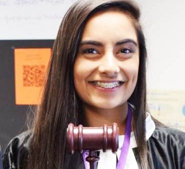 Headshot of Business & Law student holding a gavel
