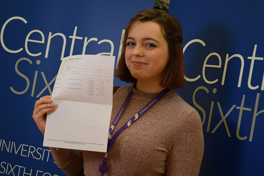 Emma Kieran former Central St Michael's Sixth Form student with their A-Level results