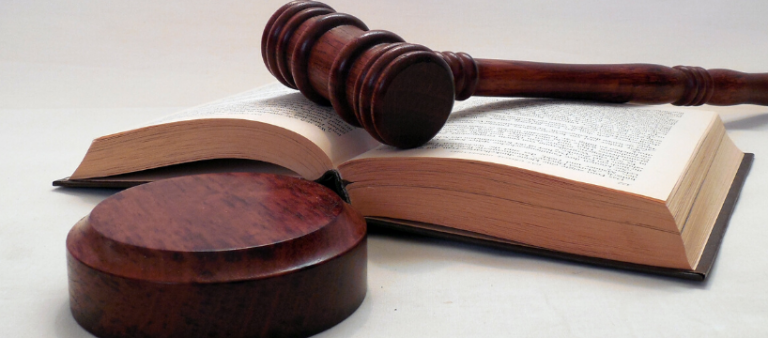 Brown gavel placed on a book