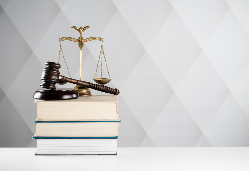 Judges gavel on top of a stack of books