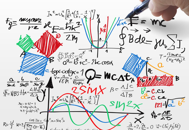 Numerous maths equations on a whiteboard