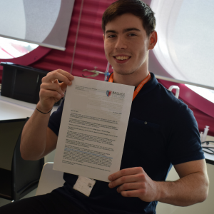 Louie Clarke pictured with his offer letter from Oxford University