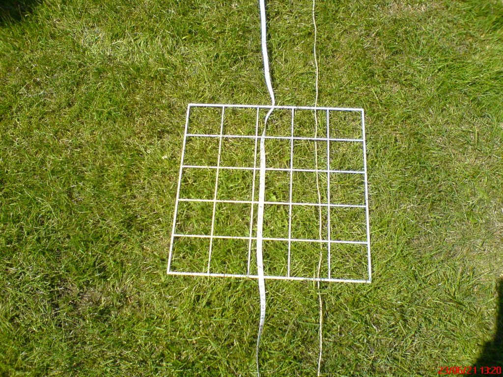 White grid and tape on grass